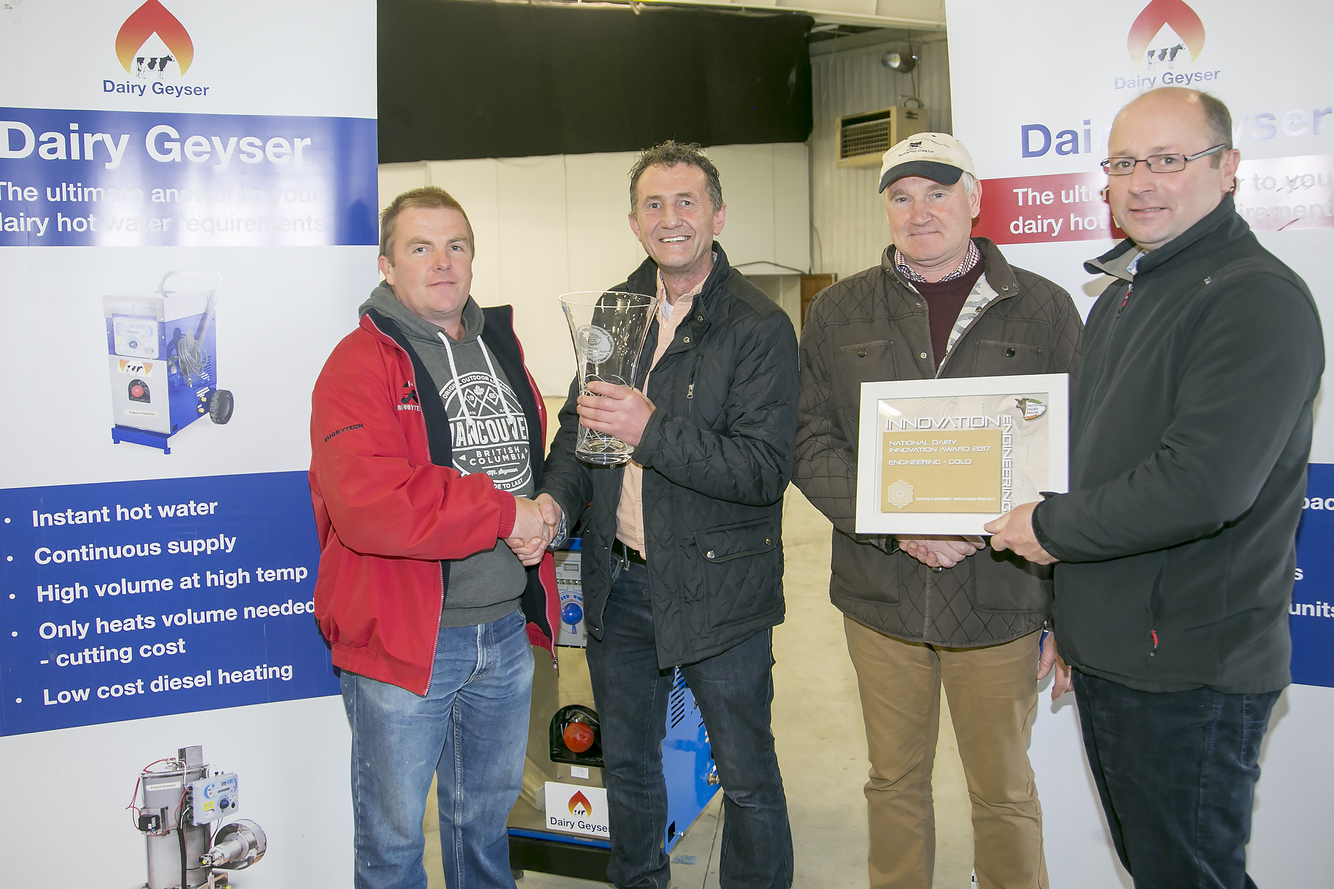 Dairy Geyser, Gold engineering Award and Overall winner Pictured is Judge Kevin Ahern presenting the Trophy to Martin Deady with John Joe Cotter receiving the Award Certificate from Don Crowley Dairy Geyser is a superbly Engineered and innovative Geyser which is designed to run on diesel providing a low cost solution for a farm's hot water need's